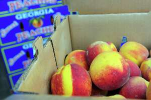 The Georgia Peach Truck made a stop at McArdle's Florist & Garden Center as part of its East Coast Road Trip 2019 in Greenwich, Conn., on Saturday August 3, 2019. The truck delivered farm-to-street boxes of Rolling Freestones, the freestone Georgia peaches from Dickey Farms. The line to purchase the peaches stretched through the entire garden center.