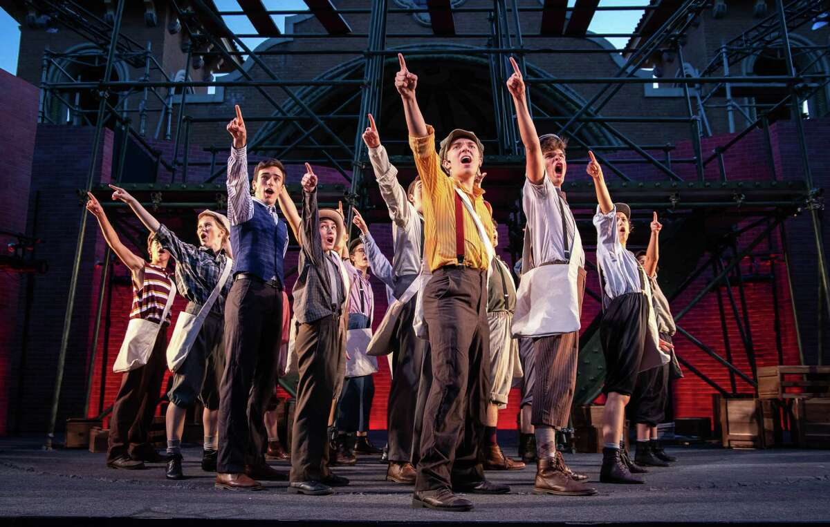 """Jake Goodman (in orange at center) and members of the cast of the musical """"Newsies,"""" being performed by the students of Playhouse Stage Company in Albany's Washington Park.(PSC publicity photo byMolly Rose McGrath.)"""