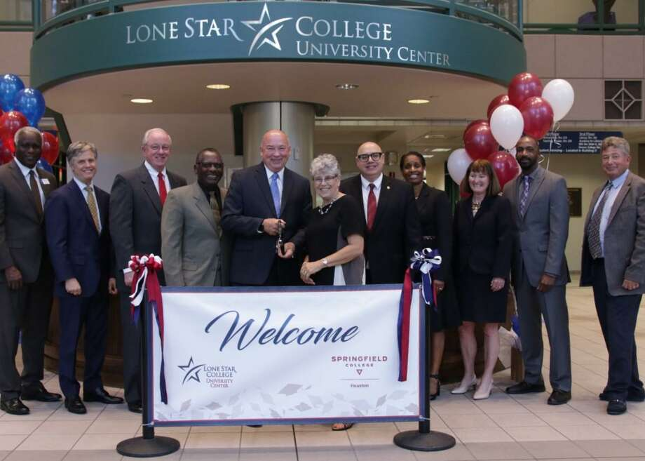 Springfield College of Massachusetts joined the ranks of partner universities at Lone Star College-University Center to offer bachelor's of science degrees in human services to LSC students who obtain their associates degrees. Here,Archie Blanson, LSC vice chancellor of student success; Dwight Smith III,LSC vice chancellor of academic success; Mike Sullivan, LSC trustee; Alton Smith, board of trustees chair; Stephen C. Head, LSC chancellor; Martha Potvin, Springfield College provost and vice president for academic affairs; John Eisler, Springfield College associate vice president for academic affairs; Benita Williams, Springfield College Houston assistant director of administration; Helen Clougherty, LSC vice chancellor, chief of staff and board liaison; James McGee, LSC vice president of instruction and Link Alander, LSC vice chancellor of college services pose during the ceremony marking the partnership. Photo: Submitted Photo / Submitted Photo