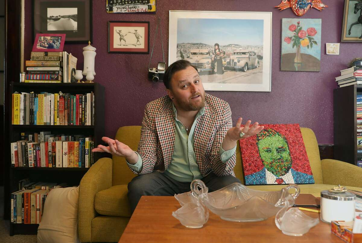 Contemporary american travel writer and blogger Stuart Schuffman, aka Broke-Ass Stuart, seen in his living room at home on Tuesday, July 30, 2019 in San Francisco, Calif.