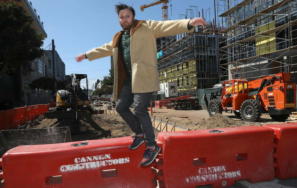 Stuart Schuffman, aka aka Broke-Ass Stuart, seen near new construction in his neighborhood on Tuesday, July 30, 2019 in San Francisco, Calif. Homeless and new construction is some of the stories he covers on his website. He also faces a potential eviction now that his landlord is selling his building.