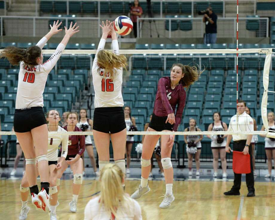 Danyle Courtney (14) of Cinco Ranch attempts a kill shot past Allison Parks (10) and Maddie Waak (16) of Katy in the second set of a Class 6A - III Regional Quarterfinal playoff volleyball match between the Cinco Ranch Cougars and the Katy Tigers on Monday, November 5, 2018 at the Leonard Merrell Center, Katy, TX. Photo: Craig Moseley, Staff / Staff Photographer / ©2018 Houston Chronicle