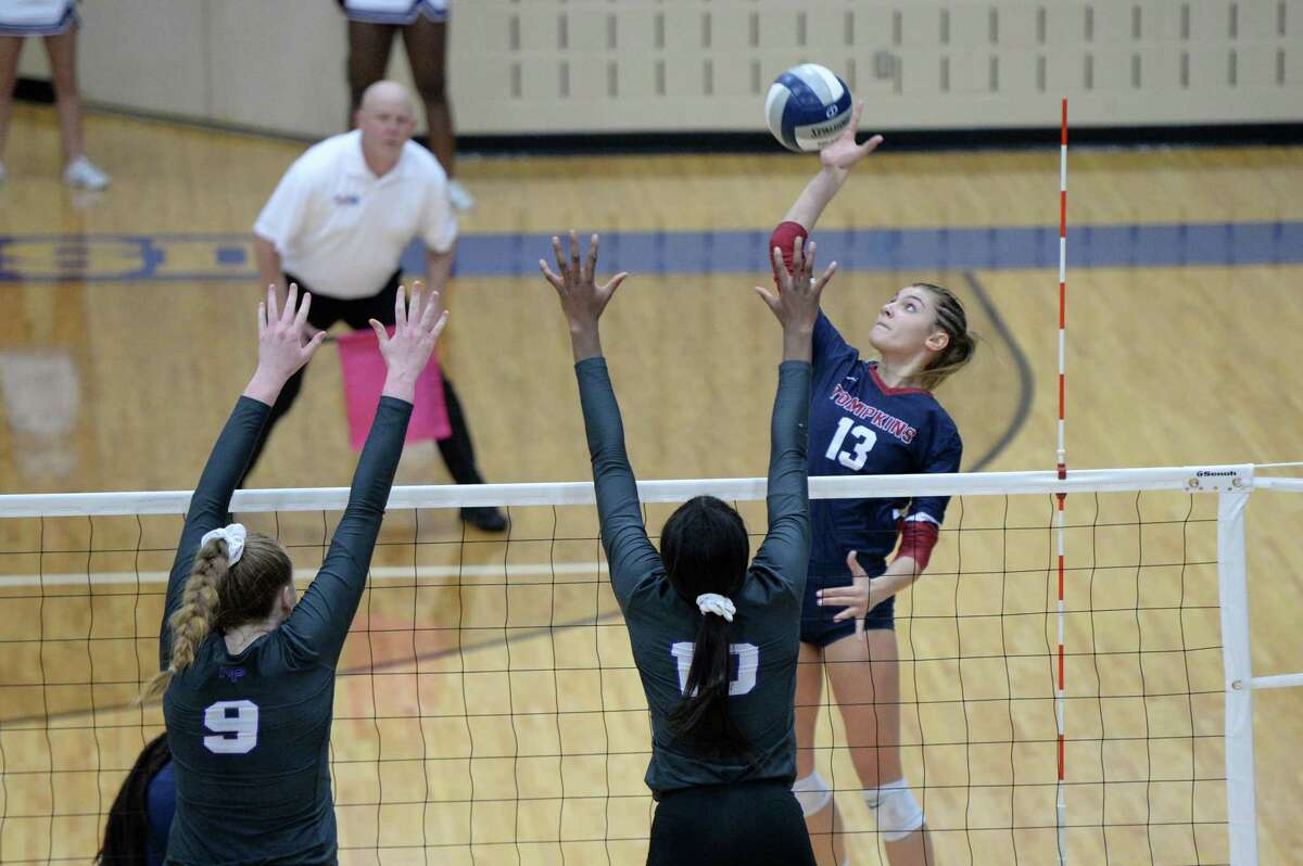 Paris Herrman (13) of Tompkins attempts a kill shot in the second set of a bi-district playoff volleyball match between the Ridge Point Panthers and the Tompkins Falcons on October 30, 2018 at Wheeler Fieldhouse, Sugar Land, TX.