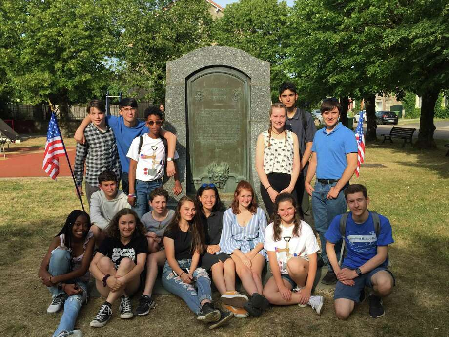 "Ridgefield High School seniors Aaron Cohen and Mairead Lacey were among a group of 15 students who participated in the ""Digging Into History: WWI Trench Restoration"" program in Seicheprey, France, this summer. The program took participants to the site of the first German offensive against American troops to restore a section of trench once occupied by Connecticut's 102nd Infantry Regiment. The group is pictured here at the Connecticut Fountain at Seicheprey. Photo: Christine Pittsley / Connecticut State Library"