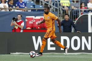 FOXBOROUGH, MA - JUNE 29: Houston Dynamo defender Chris Duvall (12) pushes forward during a match between the New England Revolution and the Houston Dynamo on June 29, 2019, at Gillette Stadium in Foxborough, Massachusetts. (Photo by Fred Kfoury III/Icon Sportswire via Getty Images)