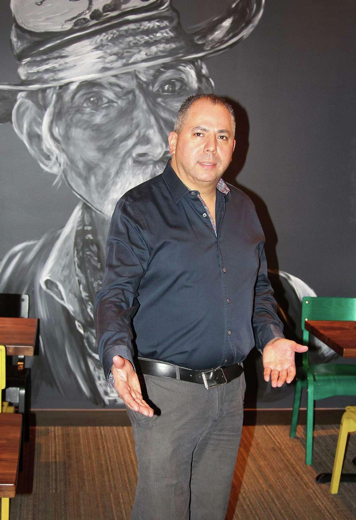 Esaul Rodriquez, owner of Puerto Vallarta in Danbury stands in his restaurant on Wednesday, Nov. 16, 2016.