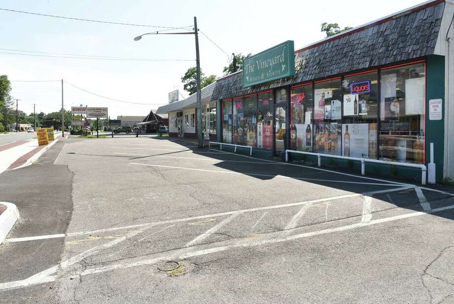 A liquor store is seen in a strip mall along Hamburg St. on Monday, Aug. 5, 2019 in Rotterdam, N.Y. Commerce did not return as promised by the Department of Transportation after the construction to widen the street. (Lori Van Buren/Times Union) Photo: Lori Van Buren, Albany Times Union / 40047592A