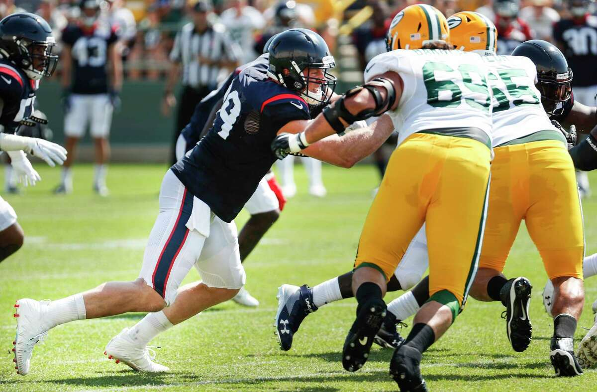 Houston Texans defensive end J.J. Watt (99) goes up against Green Bay Packers offensive tackle David Bakhtiari (69) during a joint training camp practice on Monday, Aug. 5, 2019, in Green Bay, Wis.