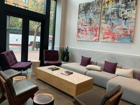 "YOTEL's lobby has a modern space with purple accents. YOTEL is San Francisco's latest micro-hotel on Market St. that offers 10 different cabins that range in all sizes. I stayed in the ""Interior Sky"" cabin with a total of 86 square feet (8 square meters). Photo: Susana Guerrero/ SFGATE"
