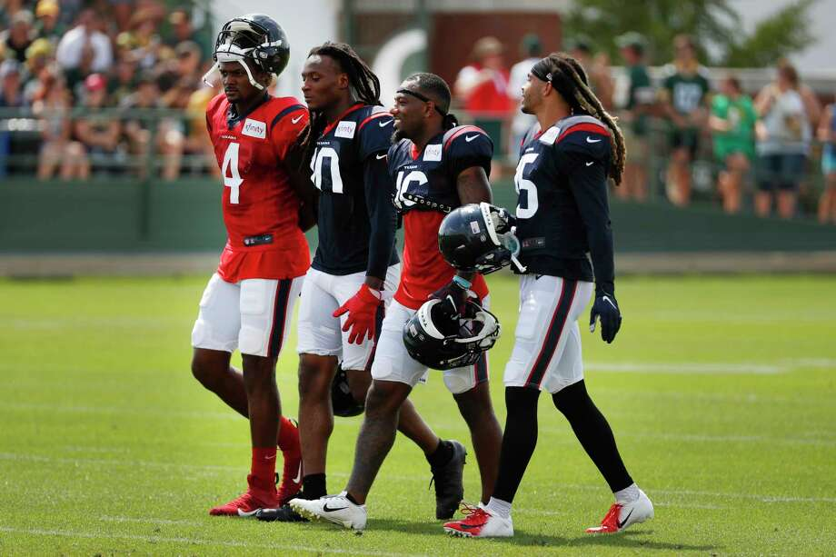 Houston Texans quarterback Deshaun Watson (4) walks with wide receivers DeAndre Hopkins (10), Keke Coutee (16) and Will Fuller (15) during a joint training camp practice with the Green Bay Packers on Monday, Aug. 5, 2019, in Green Bay, Wis. Photo: Brett Coomer, Staff Photographer / © 2019 Houston Chronicle