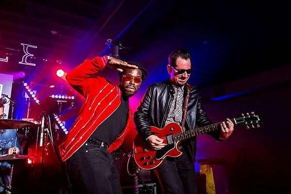 Eric Burton and Adrian Quesada on stage fronting Black Pumas