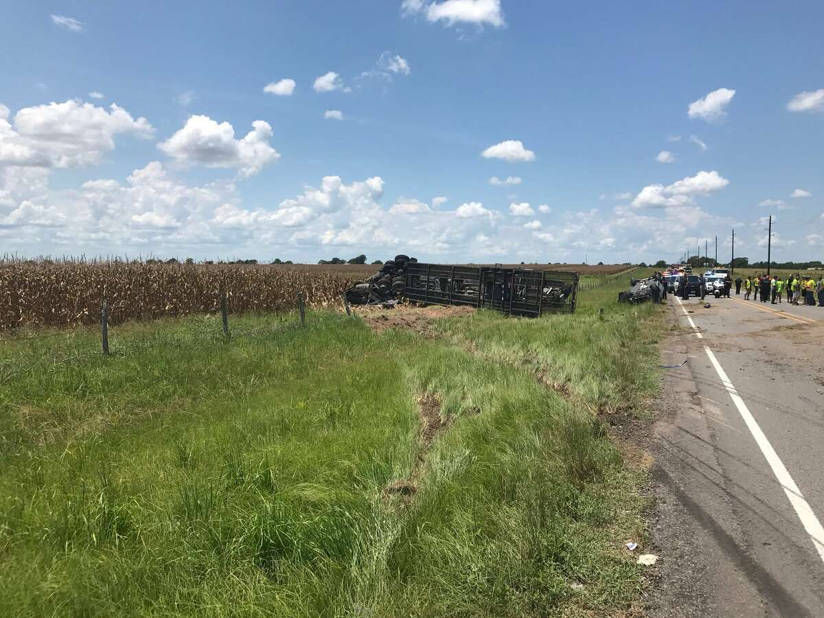The driver of a truck hauling five cars died Monday after hitting an SUV and driving off FM2920, according to authorities.