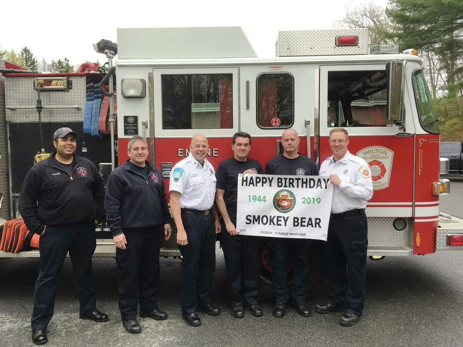 Members of the Wilton Fire Department spread the word of Smokey Bear's 75th birthday on Aug. 9, 2019. From left: Firefighter Noah Fouad, Firefighter Michael Wydra, Capt. Kevin Czarnecki, Deputy Fire Marshal Kevin Plank, Firefighter Mike Pryor and Capt. Brian Elliott. Photo: Contributed Photo / Wilton Fire Department / Wilton Bulletin