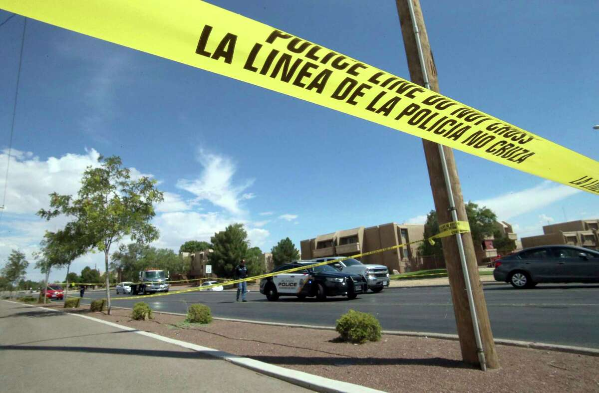 Police tape strung across an intersection behind the scene of a shooting at a shopping mall in El Paso, Texas, on Saturday, Aug. 3, 2019. Multiple people were killed and one person was in custody after a shooter went on a rampage at a shopping mall, police in the Texas border town of El Paso said. (AP Photo/Rudy Gutierrez)