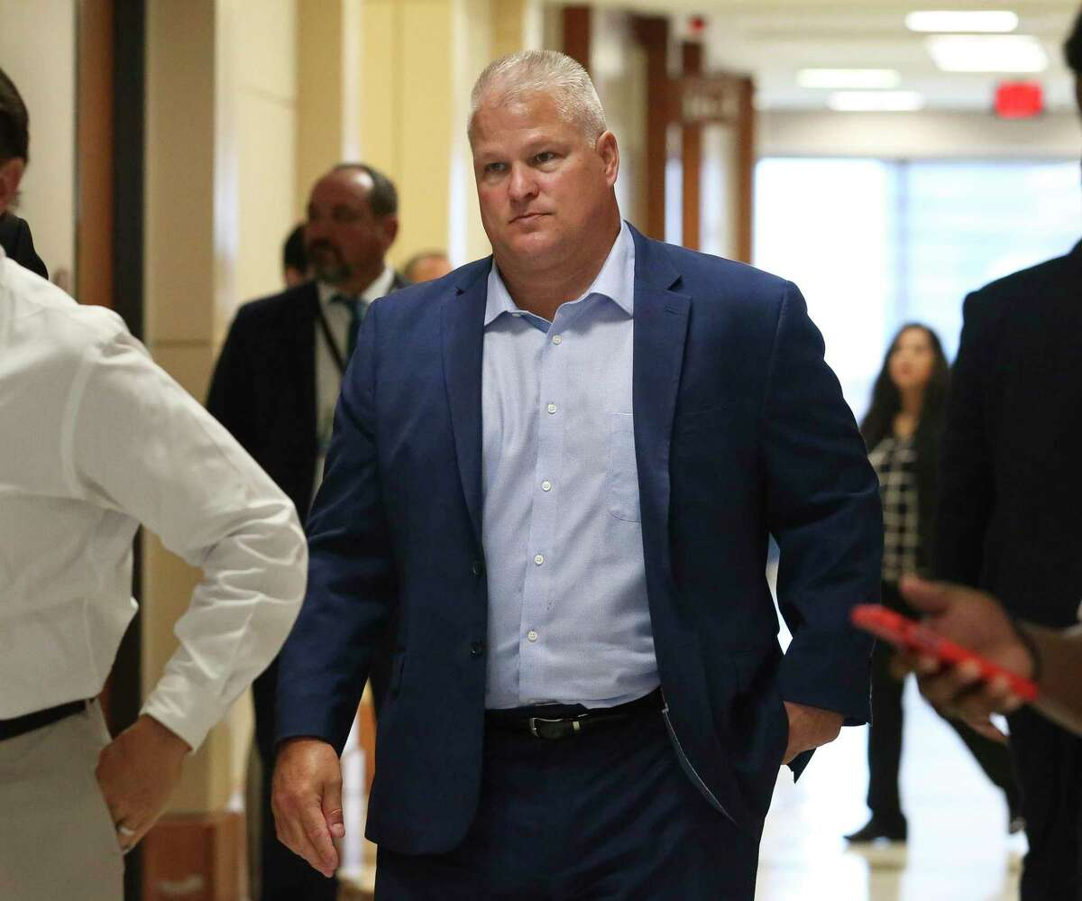 David Temple, who is accused of killing his wife, Belinda Lucas Temple, in 1999, walks back to the courtroom during a break at the Harris County Criminal Courts on Monday, Aug. 5, 2019, in Houston. Lawyers from both sides present closing arguments to the jury in the the murder retrial of Temple.