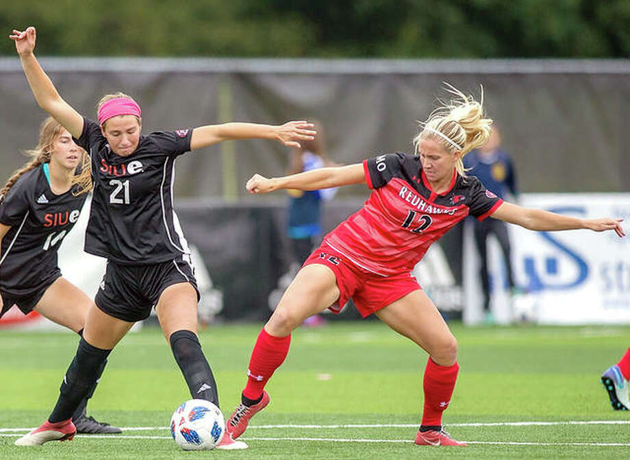 SIUE's Angel Ikeda, left, battles for the ball with Southeast Missouri's Cassidi Tomsu last season at Korte Stadium. The Cougars will play preseason games against Illinois State, Saint Louis U. and IUPUI before beginning the regular season Aug. 23 at Northern Colorado. Photo: SIUE Athletics