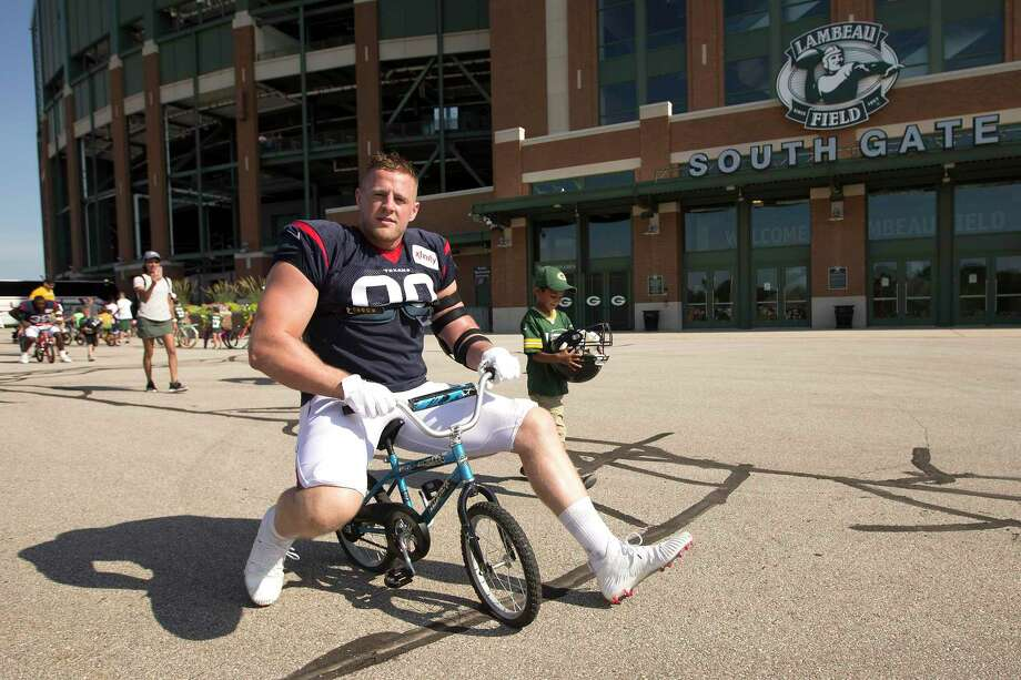 Houston Texans defensive end J.J. Watt ride a bike to practice for a joint training camp practice with the Green Bay Packers outside Lambeau Field on Monday, Aug. 5, 2019, in Green Bay, Wis. Photo: Brett Coomer, Houston Chronicle / Staff Photographer / © 2019 Houston Chronicle