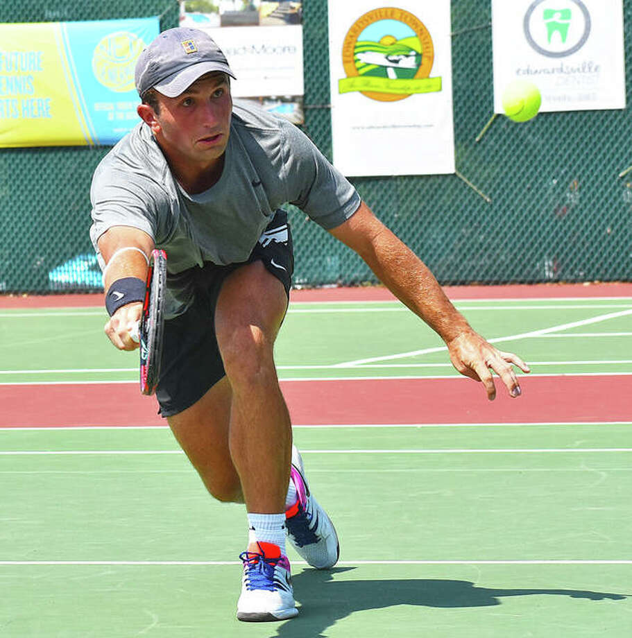 Preston Touliatos hits a shot at the net during his first-round match against Carson Haskins in the qualifying tournament of the Edwardsville Futures. Photo: Matt Kamp|The Intelligencer