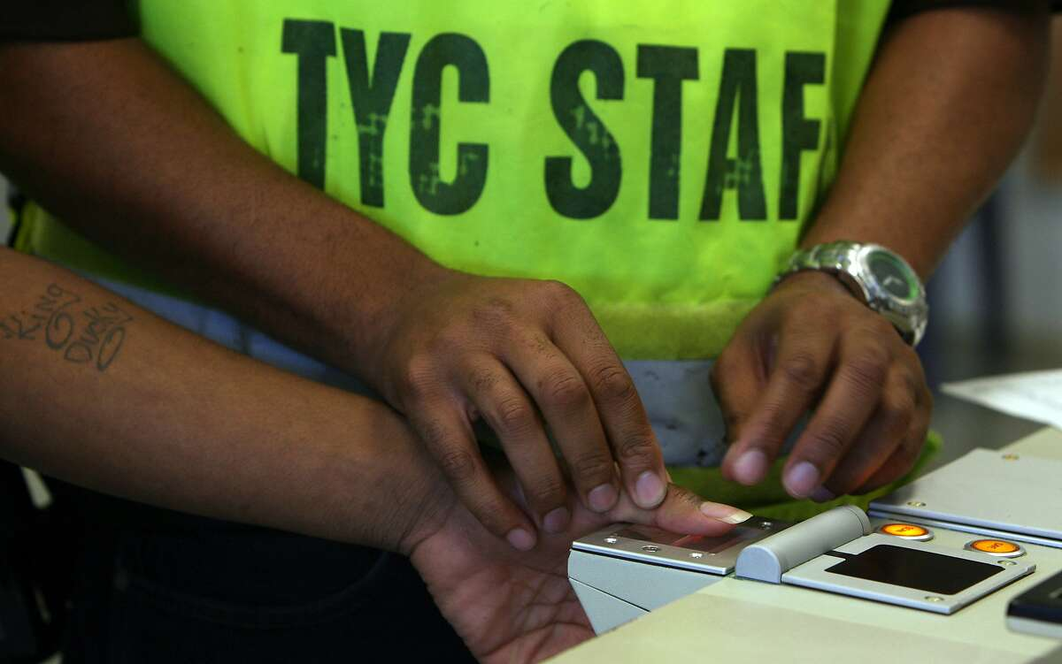 An offender at the Texas Youth Commision's McLennan County State Juvenile Correctional Facility is fingerprinted during his first day there.The minimum age for offenders there is ten years old. JOHN DAVENPORT / STAFF
