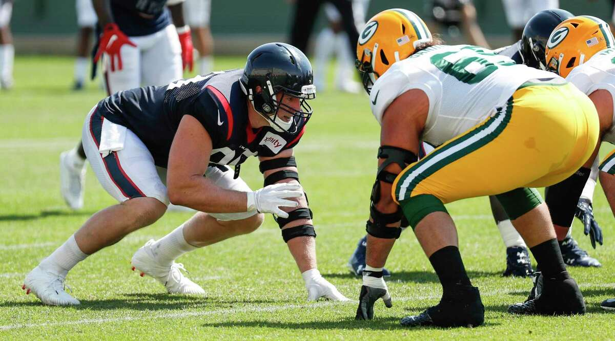 Houston Texans defensive end J.J. Watt (99) lines up against Green Bay Packers offensive tackle David Bakhtiari (69) during a joint training camp practice on Monday, Aug. 5, 2019, in Green Bay, Wis.