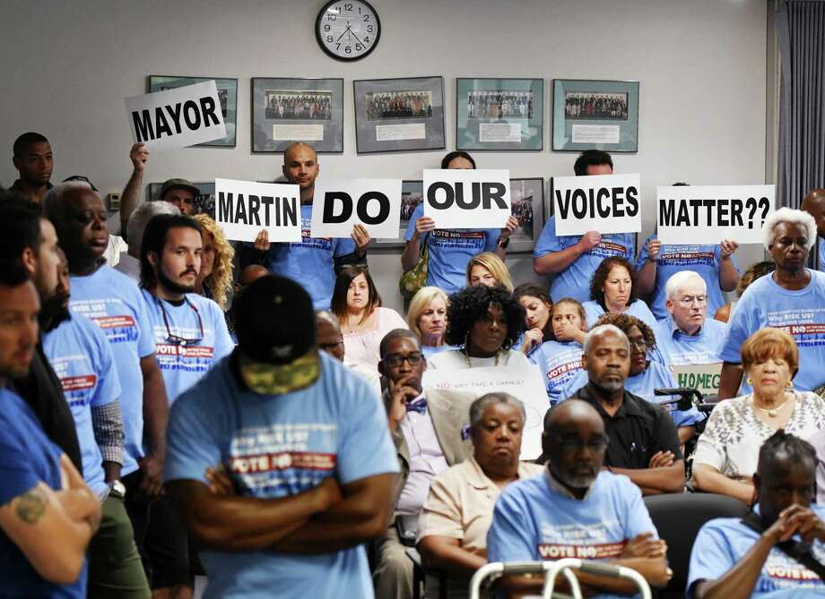 Stamford residents show their disapproval of the appointment of Chris Murtha as police chief during the Board of Representatives vote at the Government Center in Stamford on Monday. Photo: Tyler Sizemore / Hearst Connecticut Media / Greenwich Time