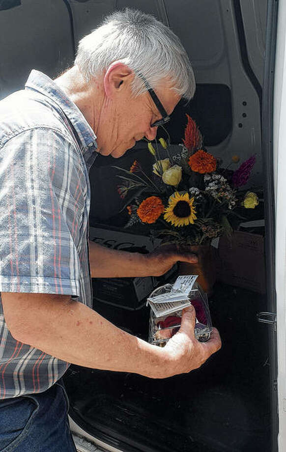 Ron Barber, owner of Barber Florist, prepares his delivery van. Businesses like Barber's that involve transportation have been hit by a hike in the state's gas tax. Photo: Marco Cartolano | Journal-Courier