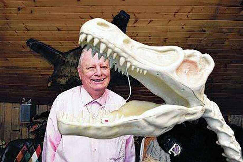 If it's unique, Tom Palmer is drawn to it. This 5 foot tall animatronic dinosaur skeleton was a gift from his son. Photo: Alex T. Paschal | The Telegraph (AP)