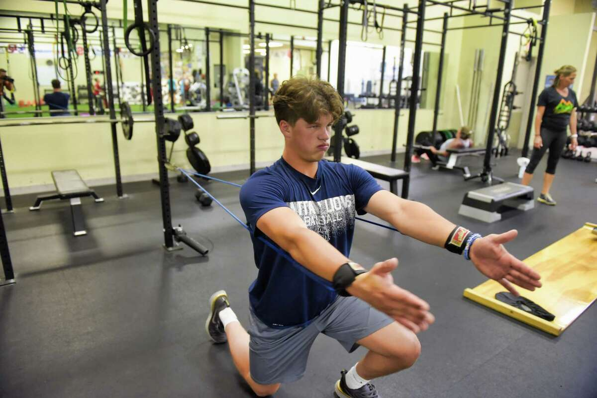 Chance Checca, Ballston Spa High School student, performs reverse flyes using J-Bands as he trains at Saratoga Peak Performance on Monday, July 29, 2019, in Saratoga Springs, N.Y. (Paul Buckowski/Times Union)