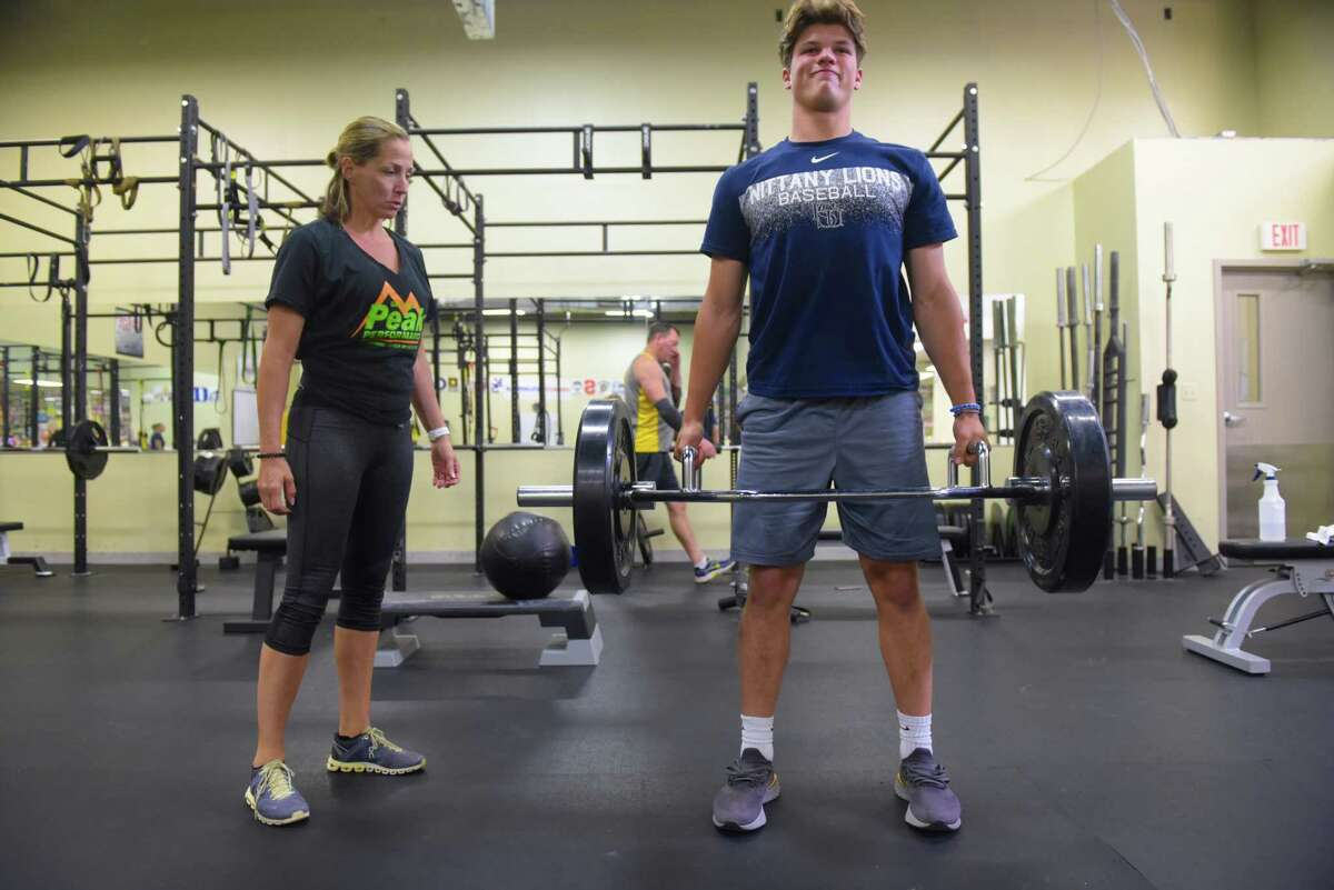 Personal trainer Cathy Winslow, left, works with Chance Checca, a Ballston Spa High School student, as he trains at Saratoga Peak Performance on Monday, July 29, 2019, in Saratoga Springs, N.Y. (Paul Buckowski/Times Union)