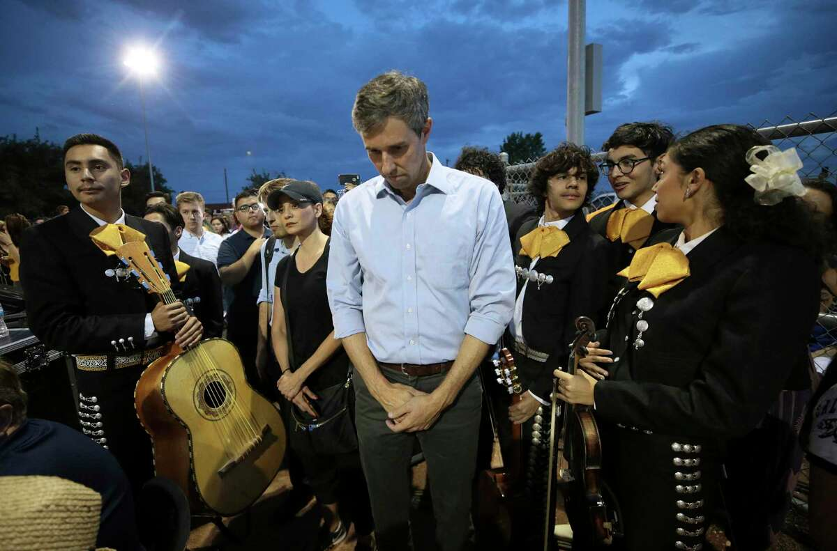 Presidential candidate Beto O'Rourke of El Paso, Texas, prays during a vigil marking the mass shooting at an El Paso Walmart. O'Rourke predicts that young people will be the force that effectively combats gun violence in the U.S.