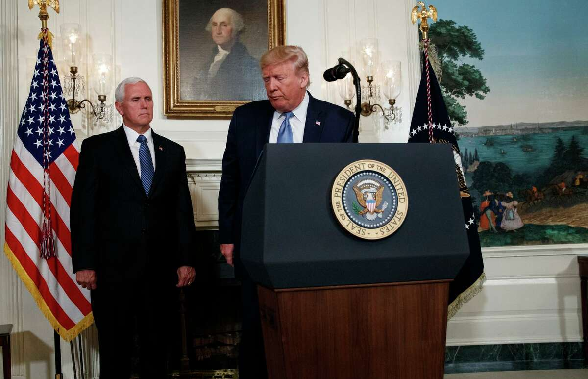 Vice President Mike Pence looks on as President Trump walks off after speaking about the mass shootings in El Paso, Texas and Dayton, Ohio, in the Diplomatic Reception Room of the White House on Monday.