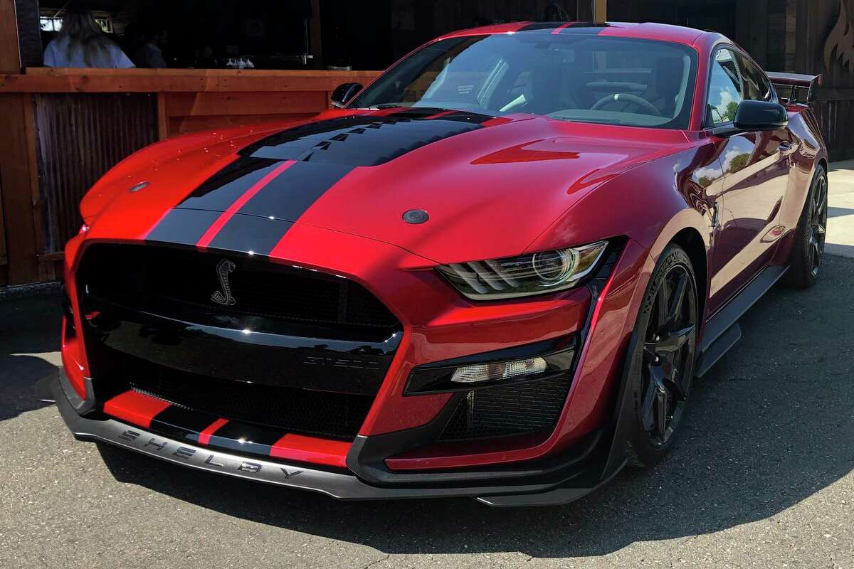 In this Tuesday, July 31, 2019, photo the the 2020 Shelby GT500 is displayed during a Ford press conference in the Detroit suburb of Clawson, Mich. The Mustang will be the most powerful street-legal Ford Mustang ever built and will go on sale this fall. (AP Photo/Tom Krisher)