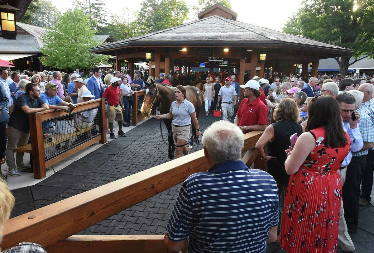 People watch as the Fasig-Tipton Saratoga Sale of Select Yearlings has started on Monday, Aug. 5, 2019 in Saratoga Springs, N.Y. (Lori Van Buren/Times Union)