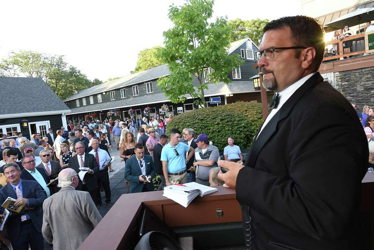 Bid spotter Patrick Morgan waits for bids from clients in the crowd as the Fasig-Tipton Saratoga Sale of Select Yearlings has started on Monday, Aug. 5, 2019 in Saratoga Springs, N.Y. (Lori Van Buren/Times Union)