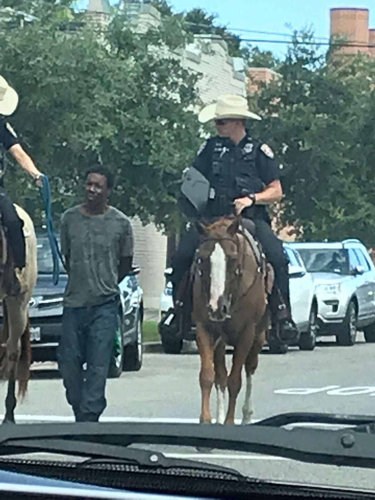 Galveston Police were placed in the national limelight after a dramatic photo circulated online showing horse-mounted officers leading a handcuffed man of color by what appears to be a rope.
