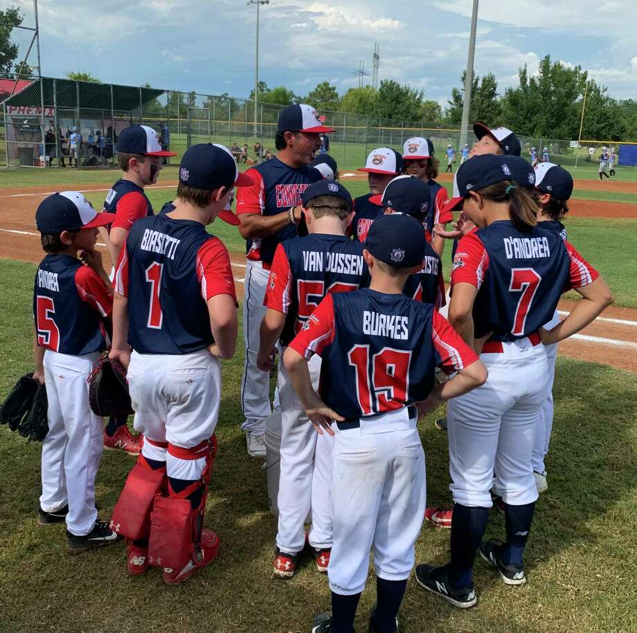 Coach Mitch Hoffman gives the New Canaan 10-year-old All-Stars a pep talk during the Cal Ripken World Series in Phenix City, Alabama, on Monday. Photo: Leah Kittredge / Contributed / Hearst Connecticut Media