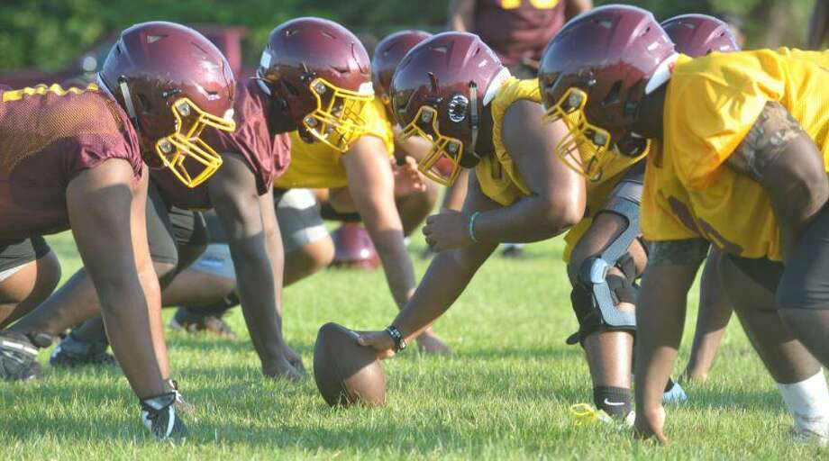 Players on the Beaumont United football team line up on Monday during the team's first practice of the 2019 season. Photo by Matt Faye/The Enterprise. Photo: Matt Faye/The Enterprise