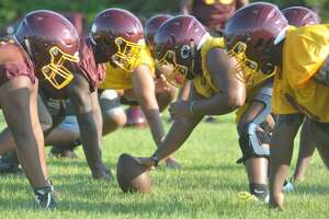 Players on the Beaumont United football team line up on Monday during the team's first practice of the 2019 season. Photo by Matt Faye/The Enterprise.