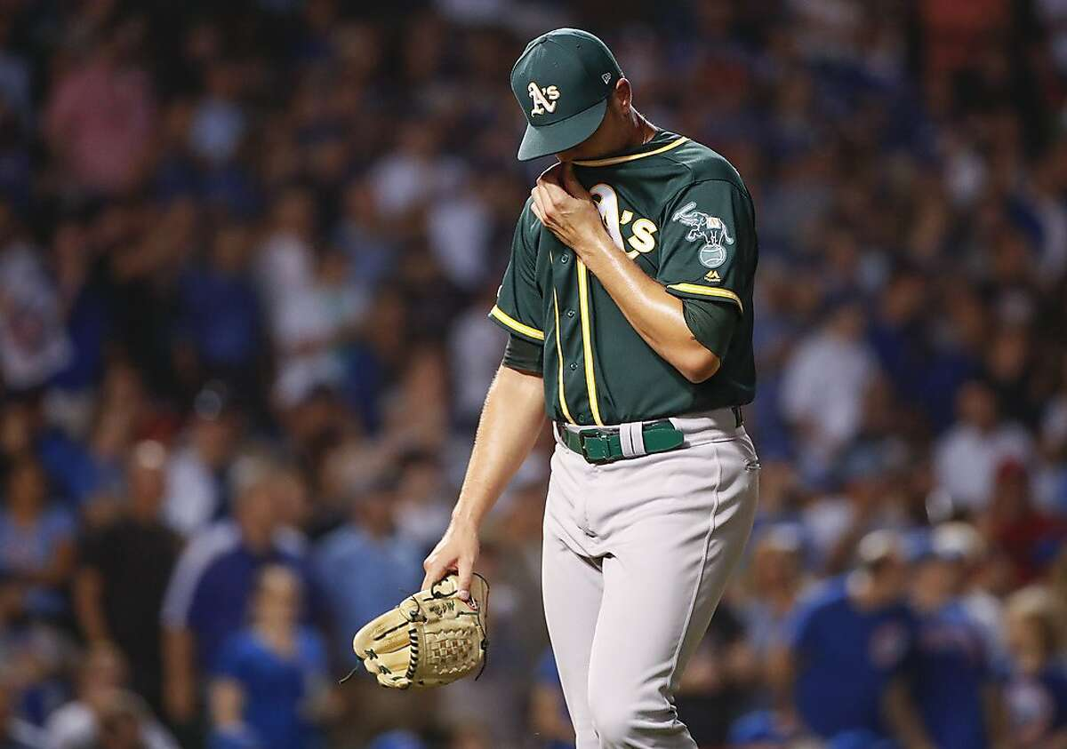 Oakland Athletics relief pitcher Blake Treinen leaves a baseball game against the Chicago Cubs during the seventh inning, Monday, Aug. 5, 2019, in Chicago. (AP Photo/Kamil Krzaczynski)