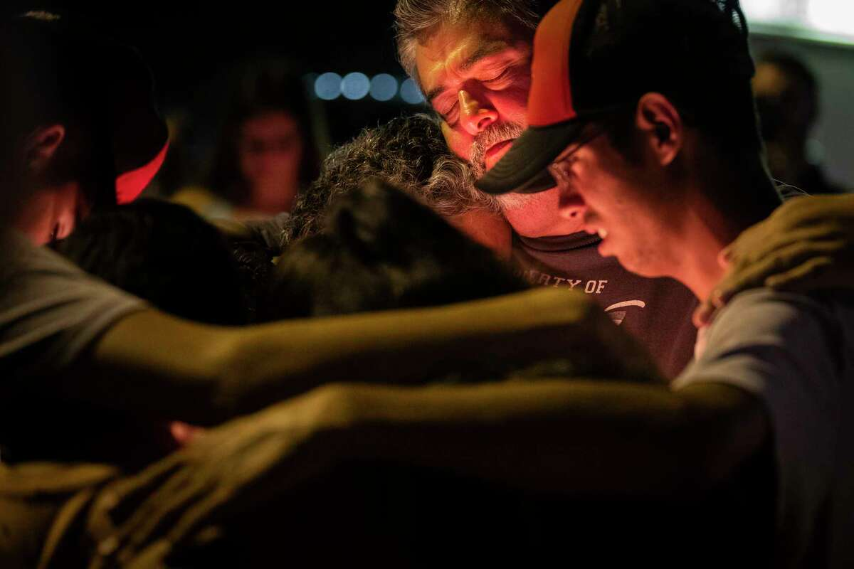 Mourners hug each other during a prayer candle vigil Monday, Aug. 5, 2019, in El Paso. The event was organized by the Immanuel Church in support of the victims of the El Paso shooting.