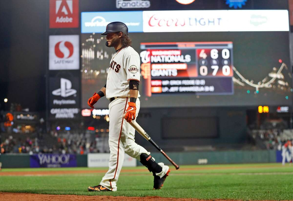 San Francisco Giants' Brandon Crawford heads back to the dugout after making final out of 4-0 loss to Washington Nationals during MLB game at Oracle Park in San Francisco, Calif., on Monday, August 5, 2019.