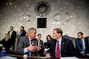 Senate Judiciary Committee Chairman Lindsey Graham, R-S.C., left, speaks with Sen. Richard Blumenthal, D-Conn., right, during a break from testimony from Attorney General nominee William Barr at a Senate Judiciary Committee hearing on Capitol Hill in Washington, Tuesday, Jan. 15, 2019. Graham and Blumenthal announced a deal on Aug. 5 for the framework of a gun control bill.
