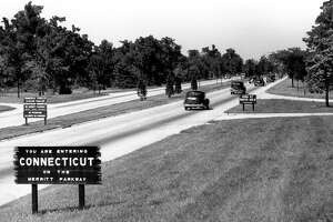 Early 1940's a sign welcomes motorists to Connecticut on the Merritt Parkway at the New York line in Greenwich . CT Departmen of Transportation photo.