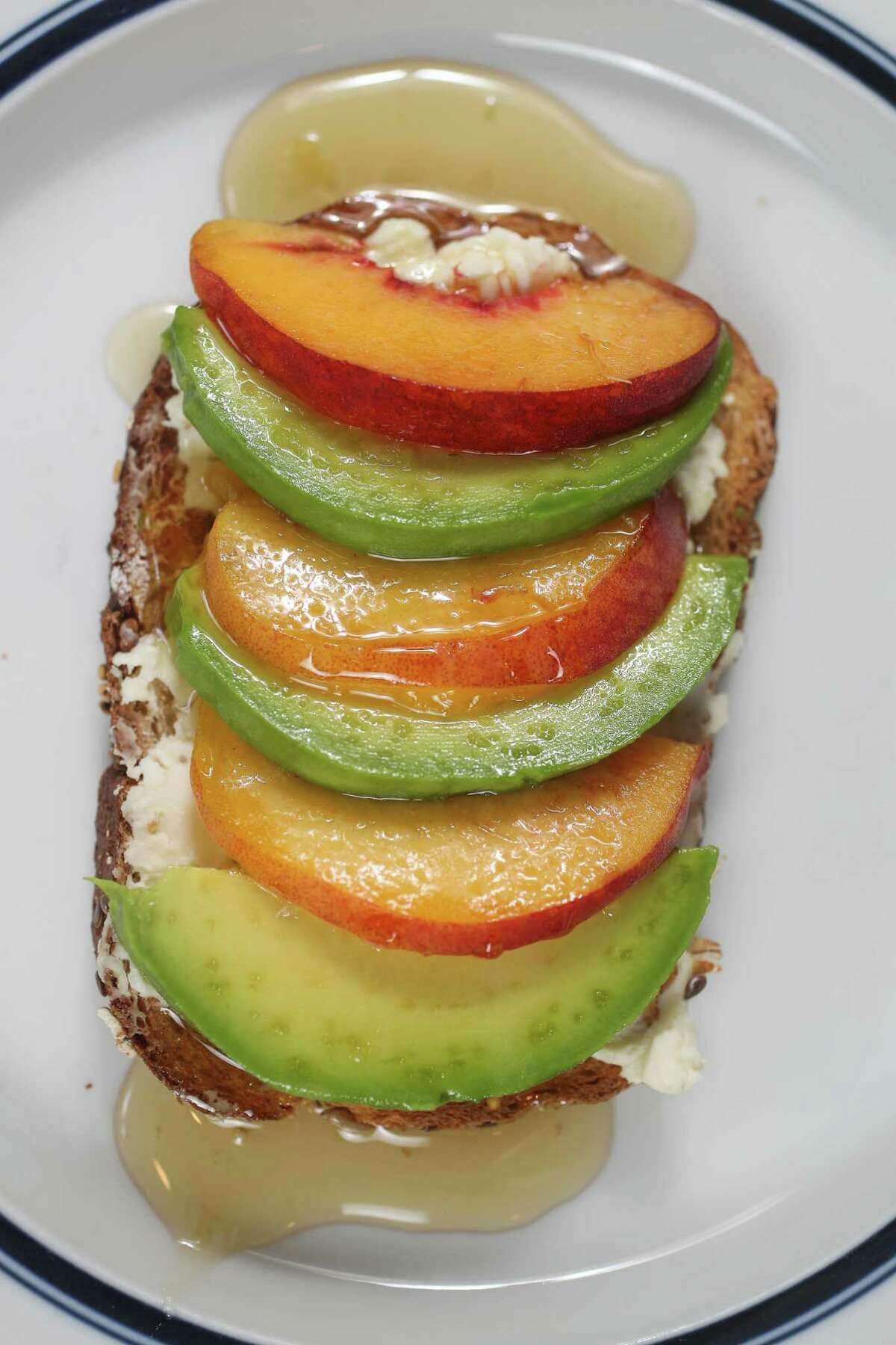 """""""The 20 Percent Down Payment"""" is our sweetest avocado toast recipe, topped with honey."""