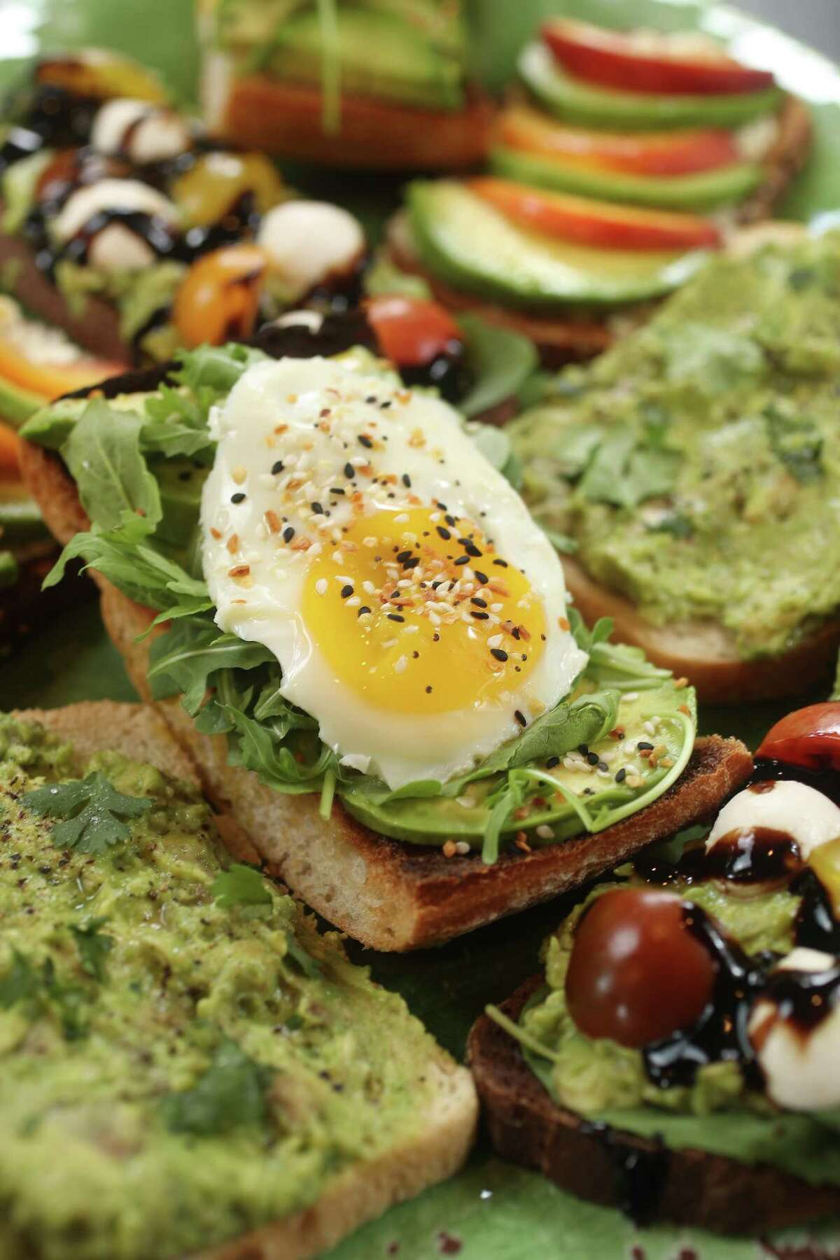 We created four avocado toast recipes that will fill the void in your life caused by crushing debt.