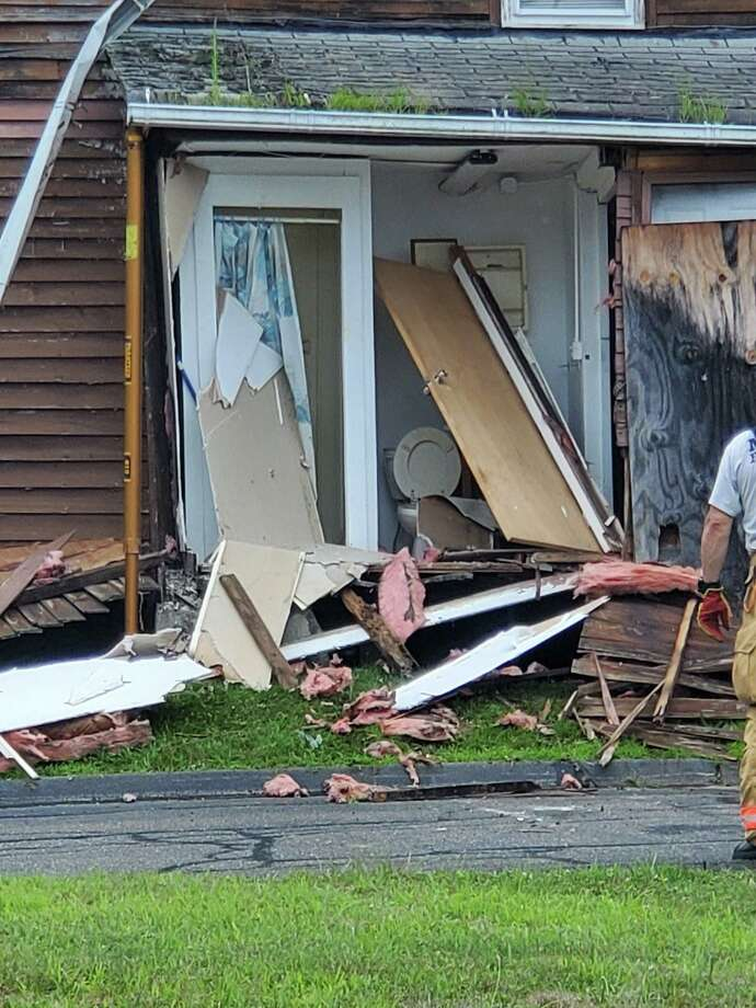 A car crashed into a house on Buckingham Avenue Tuesday morning. Photo: Milford Police Department