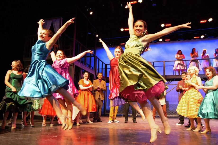 To mark its 50th anniversary, the Trumbull Youth Association (TYA) will present West Side Story in the Trumbull High School auditorium Thursday through Sunday, Aug. 8-11, with a special free senior citizen show on Wednesday, Aug. 7.  Featured dancers are (front) Daniella Chuka and Ava Mancini; (back) Ali Karpowich and Erin Knapp. Purchase tickets at trumbullyouth.org. Photo: Jens Haulund / Contributed