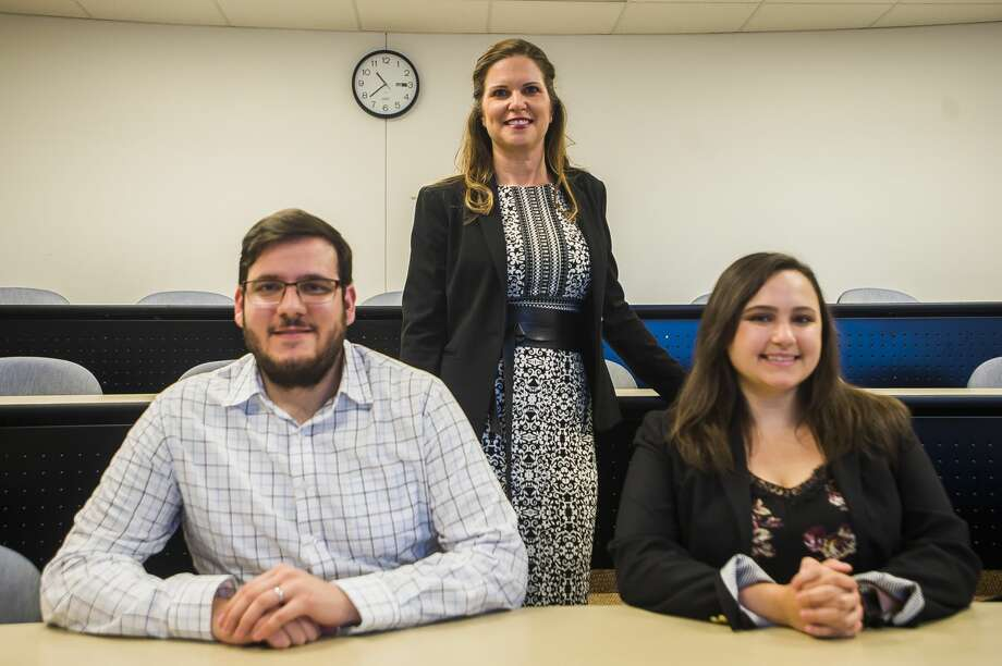 Erin Zimmer, assistant professor of marketing at Northwood University, center, and two of her students, Nicolas Pilon, left, and Amber Morin, right,  pose for a portrait on June 19, 2019 inside a classroom at Northwood. (Katy Kildee/kkildee@mdn.net) Photo: (Katy Kildee/kkildee@mdn.net)