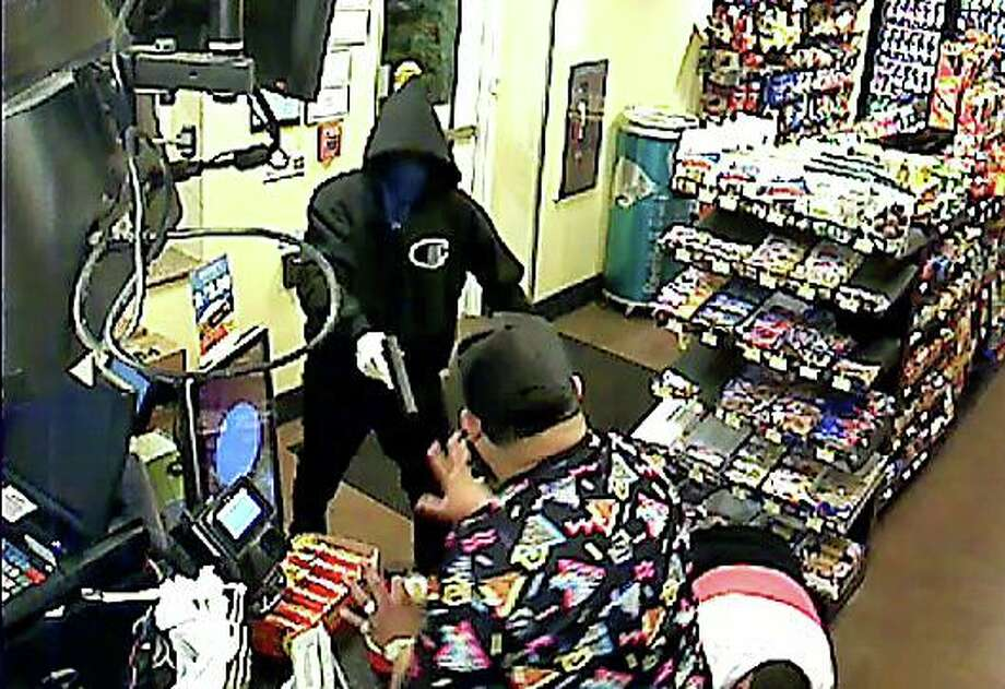 State Police are looking for two suspects in the armed robbery of a service plaza on the Wilbur Cross Parkway early Tuesday morning on Aug. 6, 2019. Photo: State Police Photo