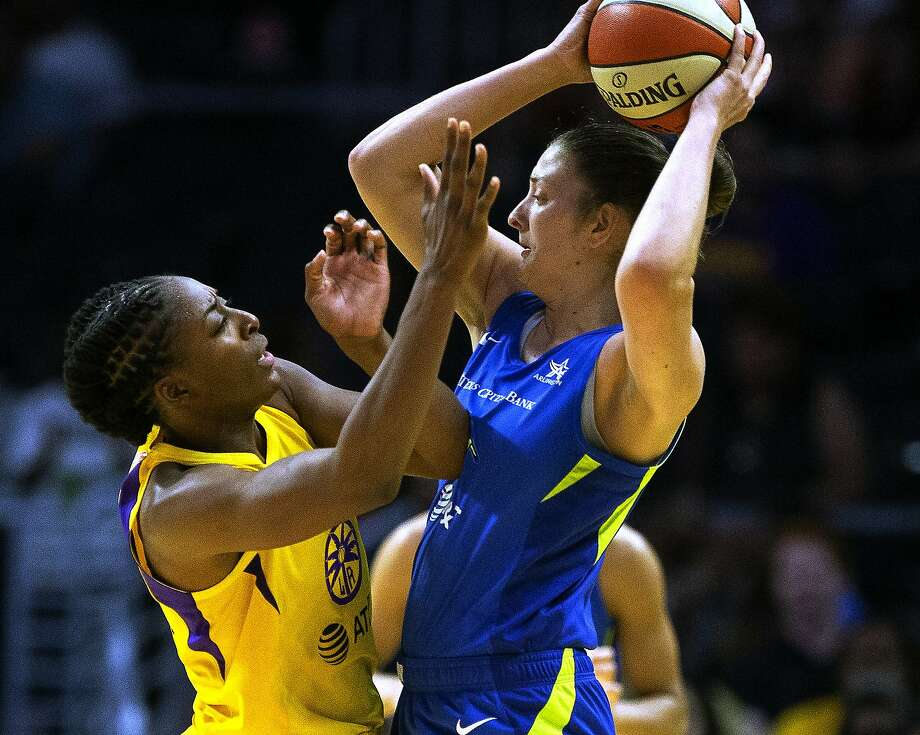 Los Angeles Sparks forward Nneka Ogwumike, left, defends against Dallas Wings' Theresa Plaisance during a WNBA basketball game in Los Angeles on Thursday, July 18, 2019. Plaisance now plays for the Connecticut Sun. Photo: Damian Dovarganes, Associated Press